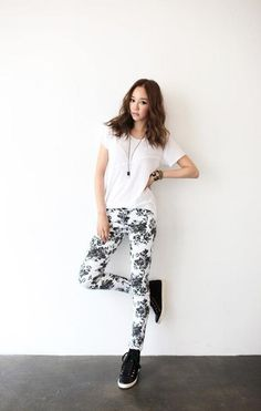 korean fashion - white top, floral leggings, and black high top sneakers