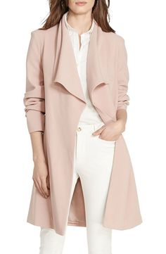 Swooning over this blush-colored drape coat from Pald Lauren. A shoulder-spanning collar caps off the clean, minimalist look.
