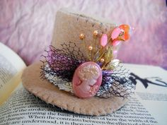 Light Brown steampunk Mini top hat with cameo via Etsy