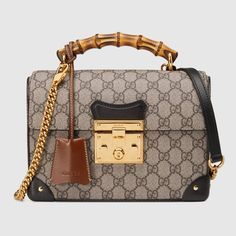 Get the trendiest Cross Body Bag of the season! The Gucci Padlock Small Bamboo Beige/Ebony Gg Supreme Canvas Cross Body Bag is a top 10 member favorite on Tradesy. Gucci Bamboo Bag, Gucci Crossbody Bag, Gucci Pouch, Gucci Gucci, Gucci Men, Gucci Padlock, Gucci Store, Gucci Gifts, Boston Bag
