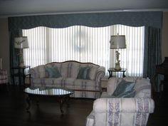 Shaped Cornice over Drapery Panels over Sheer Vertical Wrap. Custom Pillows.