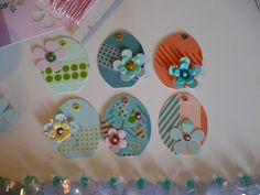Made These little easter egg hang tags! Yup! They all have names too! Starting with paint chips and little tidbit lovelies from my private collection.  Punched em' from paint chips and the name of the color happened to be on the back side! from top left...Happy Green, Telltale Teal, Orange-a-tang, Zen, Coastal, and Miami Peach! OMG! Love them.