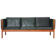 Exposed Teak Frame Sofa in Emerald Green Leather by Hans J. Wegner for Getama ca.1960's | From a unique collection of antique and modern sofas at http://www.1stdibs.com/furniture/seating/sofas/