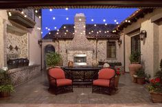 Bella Pardiso at Thompson Crossing 2008 Northern Colorado Parade of Homes - The exterior fireplace, fountains and streamed lighting make this courtyard the perfect place to entertain.
