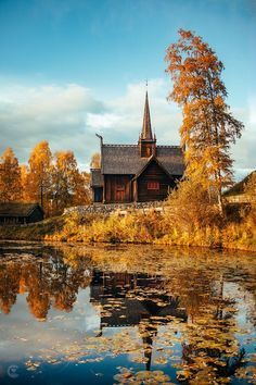 Viking church by an autumnal pond, Lillehammer, Norway