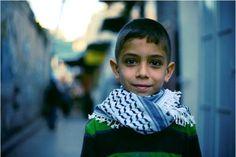 "PalestinePalestinian boy wearing arafat shawl. Also known as ""arabic scarf"" or keffiyeh.Image: Ruben van Duin"