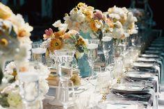 Vintage elegance wedding ~ Vintage garden roses, parrot tulips and peonies arranged in mint green vases