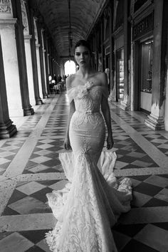 Off the shoulder lace wedding dress in trumpet silhouette and belt at waist. Click through to see more shoulder baring wedding gowns: http://www.mywedding.com/articles/shoulder-baring-wedding-dresses/