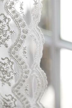 Crisp white linens in a sunny window