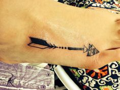 Arrow tattoo on foot. Love