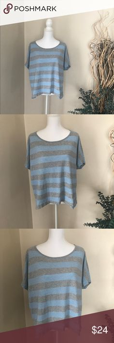 Cabi, Striped Top With An Uneven Hem, .. Size Med Beautiful gray and pastel purple top in excellent condition. The Hem is uneven. Almost like a sharkbite hem, but it's not quite there. It's very soft and, it's 100% cotton. CAbi Tops Tees - Short Sleeve
