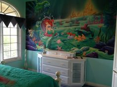 This is my 3 year old's 'Little Mermaid' themed room. I got the wall mural from Amazon and the quilt from HomeSense. You can't see the mermaid sheets but they are from Pottery Barn Kids.