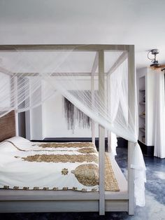 Living style: bedroom with gorgeous silk embroidered bedspreads on cream fabric