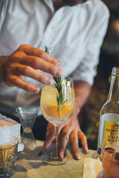The Barcelona Gintonic is exactly what is sounds like: a familiar cocktail with a Barcelona Wine Bar twist! It's a refreshing drink for warm breezy days, and easy to make, so it's perfect for parties on the patio or by the pool. INGREDIENTS 1 Orange Wedge 1 Lemon Wedge 1 Rosemary Sprig 2 oz. Millers London Dry 4 oz. Fevertree tonic ( 1/3 of bottle) STEPS OF PREPARATION Rub the rim of a wine glass with lemon and Orange wedges, squeeze, then drop into glass. Fill glass 3⁄4 of the way with…