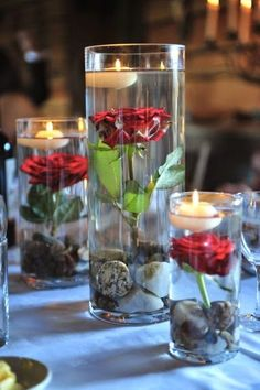 Absolutely love this idea. Lol when Amy was doing her wedding with red I suggested this for centerpieces