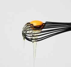 A whisk which separates the egg white from the yolk designed by Ivan Zhang. By slightly modifying the shape with a circular indention, the whisk catches the yolk, allowing the white to drip down. The whisk can then be used as normal to beat the eggs or stir your mixture. | Yanko Design