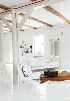 White Barn Walls + White Sofa + Barn Beams + Brown & White Cowhide Rug