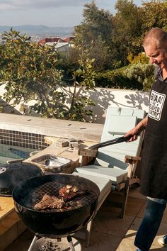 "Jean Nel, renowned for his braais, wrote a best-selling cookbook in 2011. He handed in the manuscript with one stipulation: Its title, ""Braai the Beloved Country,"" was not negotiable. (Photo: Joao Silva/The New York Times)"