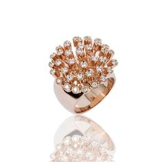 Carla Amorim Dandelion ring in pink gold with diamonds, from the Forest collection. Discover the Brazilian jewellery designer bringing her playful and fashion high jewellery all the way from Brazil: http://www.thejewelleryeditor.com/jewellery/carla-amorim-best-brazilian-jewellery-designer-history/ #jewelry
