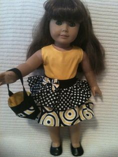 18 inch doll (modeled by American Girl) Spring and Summer party dress and purse. $12.00, via Etsy.