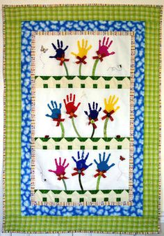 hand-print quilt.  Wouldn't this be neat to set up, and do a yearly handprint of your little one, then quilt it when they turned 18, 21 or some other big milestone!
