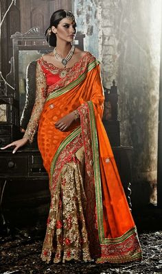 Glam up your monotonous style as you drape on this orange and beige georgette net embroidered sari. The floral patch, moti, resham and stones work seems to be chic and aspiration for any celebration. Upon request we can make round front/back neck and short 6 inches sleeves regular saree blouse also. #NewAwesomeTrendsetterSaree