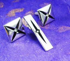 These cufflinks and tie clip would fit either for weddings or any fancy occasion out. They are a Large Crossed X in Black Enamel with a Faux