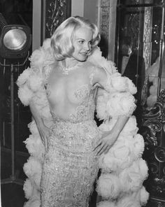 The 47 most scandalous dresses of all time: Caroll Baker in 1964 wears a provocative transparent balmain dress.