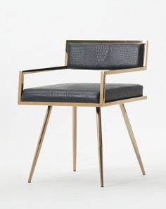 The Rosario dining chair is a magnificent display of grace featuring black crocodile textured leatherette upholstery with stiletto rose gold stainless steel legs. Features: Upholstered In Black Crocod