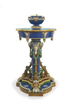 A MINTON MAJOLICA MONOGRAMMED FOUNTAIN, POTENTIALLY MADE FOR THE LONDON INTERNATIONAL EXHIBITION OF 1862  | DATED 1861-1862, THE FOUNTAIN STEM INCISED 1861, THE CAT-MASK SECTION WITH IMPRESSED UPPERCASE MARK, DATE CYPHER FOR 1862 AND CYPHER, THE BASE ENAMELED WITH A CMC MONOGRAM LIKELY FOR COLIN MINTON CAMPBELL  | EUROPEAN CERAMICS, GLASS & CHINESE EXPORT ART Auction | 19th Century, architectural | Christie's