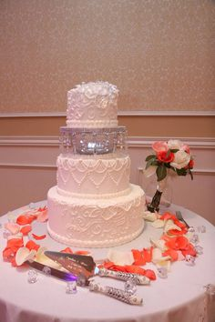 """I like this way of separating the top """"keep tier"""" from the rest of the """"eat tiers"""" Wedding cake with lace, candle light, and crystals"""