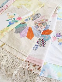 Tea towels with vintage quilt blocks trimmed with vintage fabric and lace.