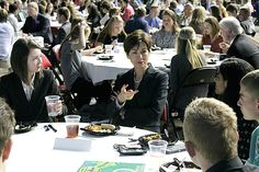 Iowa Lt. Gov. Kim Reynolds speaks with a table of students at Hilton Coliseum Monday during the World Food Prize Iowa Youth Institute event. Photo by Austin Harrington/Ames Tribune http://www.amestrib.com/news/20170424/branstad-reynolds-promote-stem-education-at-world-food-prize-event