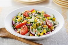 Mediterranean Marinated Vegetable Salad recipe - The epitome of the big salad: big chunks of fresh veggies, zesty flavor in every bite. Ripe peppers, zucchini, onion and cheese crumbles make this a tasty way to eat right.