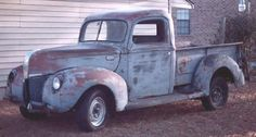 Old pickup trucks that look like they had a good life of hard work.