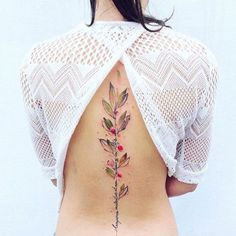 This piece cleverly hides a written message within a color-drenched berry branch. #refinery29 http://www.refinery29.com/2016/04/109196/watercolor-tattoos#slide-12