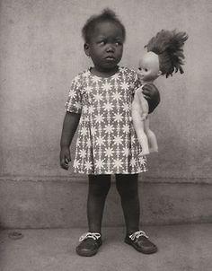 "lapetitecole:    Edouard Méhomé: A Fon child (Studio photo Vedette, Porto-Novo, Benin).  From ""Life and afterlife in Benin"" edited by Alex Van Gelder, Phaidon, 2005."