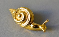 Vintage brooch slug snail gold quirky fashion costume jewelry women 70s gift statement dead stock. €25.00, via Etsy.