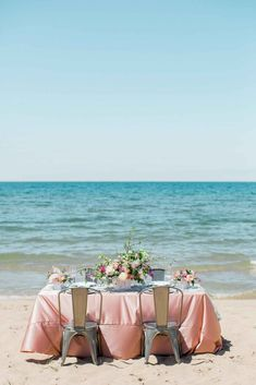 Beach wedding tablescape by the water - Love by the Shore: A Michigan-Inspired Style Shoot | WeddingDay Magazine