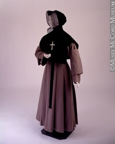"""Nun's Habit, Lucienne Simard: 1940-1979. """"This habit belonged to the Montreal congregation of the Grey Nuns. Although this type of habit was worn between 1950 and 1979, it may resemble the one adopted by the... Grey Nuns in the 18th century. The habit conceived by the order's founder, the widow Marguerite d'Youville (1701-1771), was very different from the traditional nun's habit... The Grey Nuns' habit was composed of a robe with broad pleats, a camlet garment, a domino and a black bonnet."""""""