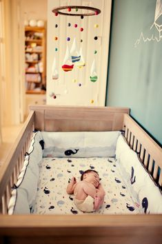 I absolutely love this... Boats on top, whales in the crib!