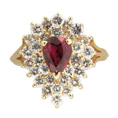 We simply love this pear-shaped ruby and diamond ring! #VintageRubyRings!