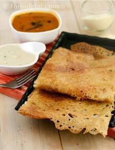 Rava dosa is a delectably crispy dosa that can be prepared instantly, without the need for any fermentation. A traditional tempering and quick mix-in of chopped onions, coriander and green chillies add excellent flavour to a batter made of ready flours. This dosa is indeed an irresistible option for breakfast, supper, snack or a sudden meal for a surprise guest.