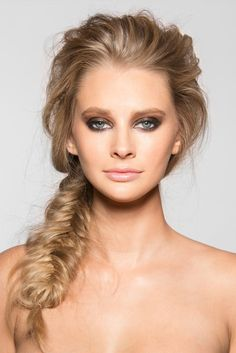 Style your hair into a messy fishtail braid.