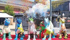 Here be dragons: Cannons fire confetti for the launch of the GoGoDragons dualling dragons sculpture at Riverside