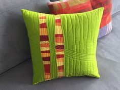 "This improv pillow in a complementary red-and-green color recipe is just the thing to brighten up your home for spring! With just one yard of fabric and a handful of scraps, you can stitch it up in no time to keep or give as a gift. Creating with curved strips is just one of the many improv techniques you'll learn in my book, Artful Improv: Explore Color Recipes, Building Blocks & Free-Motion Quilting. Fits an 18"" square pillow form. Materials: 1 yd green solid S..."