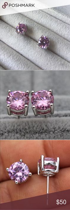 New! 18k white gold + pink topaz stud earrings New! 18k white gold + pink topaz stud earrings • Beautiful 7mm round pink topaz gems set in 18k white gold. Screwback posts. 2 sets available. Brand new untagged wholesale jewelry. Ask for a custom bundle if you would like multiple sets at a discount. Jewelry Earrings
