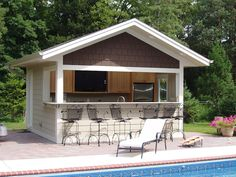 Build a bar into the side of your pool house where family can eat, drink and have fun! Add an outdoor kitchen where you can prepare cool pool treats too!
