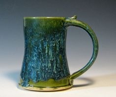 gunmetal green glaze | ... stoneware glazed in green and creamy sapphire by hughes pottery