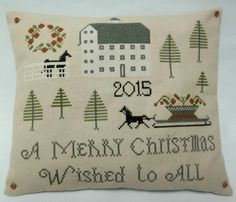Christmas Cross Stitched Mini Accent pillow / by luvinstitchin4u